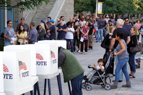 A voter marks his ballot at an early voting polling station at West Los Angeles College in Culver City, California.