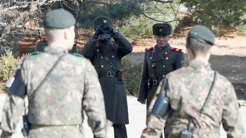 North Korean soldiers glare at their southern counterparts on the border.