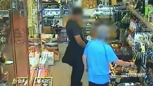 CCTV of one of the teenagers buying the knives.