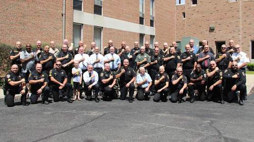 Fifty police officers shave their heads to support co-worker with leukaemia
