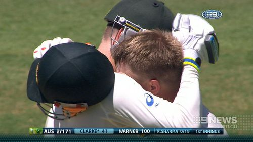 Michael Clarke and David Warner embrace. (9NEWS)