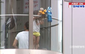 Mother and daughter trapped in glass lift during Adelaide's scorching 37-degree day