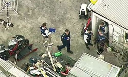 Police were seen searching a shed at the back of the property.
