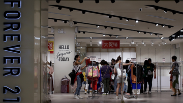 Women select clothing at an American fast fashion retailer