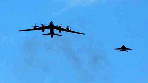 An F/A-18 Hornet strike fighter intercepts one of two Russian Tu-95 Bear bombers in 2008, over the south of Japan.