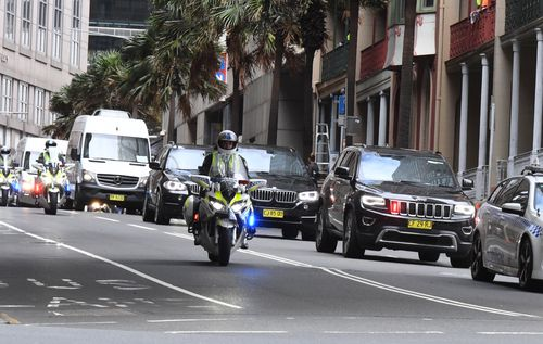 The former president's motorcade shut down Sydney streets as he made his way to his hotel. (AAP)
