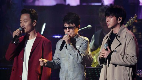 South Korean singer Cho Yong-pil and other South Korean performers rehearse ahead of their performance. (EPA)