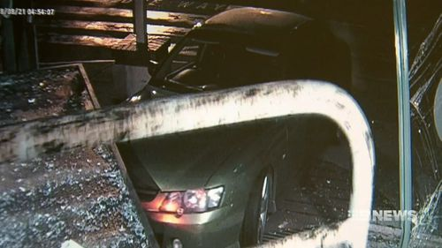 Another accomplice then used another stolen Holden Commodore to crash multiple times into the truck.