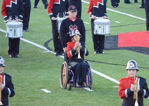Man leaves work early four days a week to push his daughter's wheelchair during marching band practice