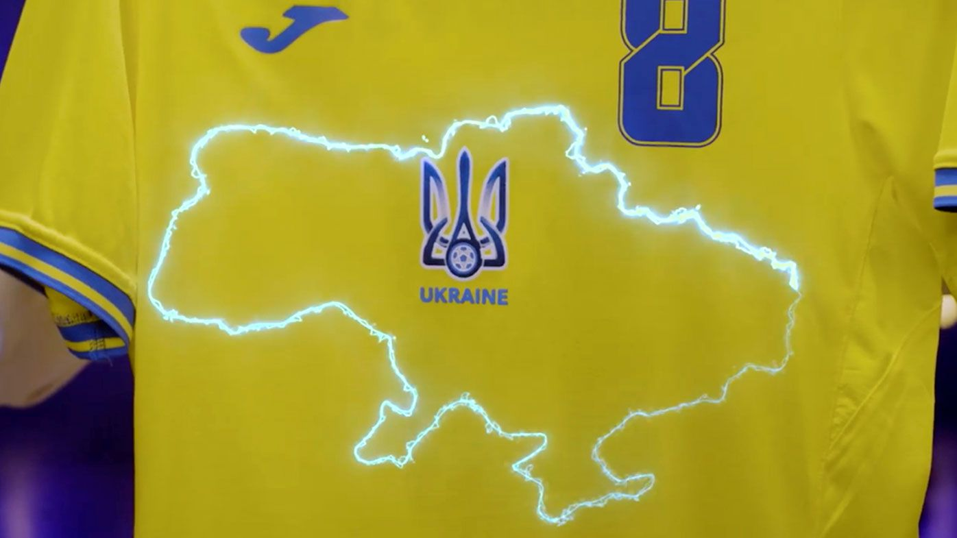 This handout photo taken from a video released by President of Ukrainian Association of Football Andrii Pavel Pavelko via Facebook, shows a new Ukraine's uniform for Ukrainian national soccer team that lights showing a map of Ukraine including Russian-annexed Crimea, Ukraine, Monday, June 7, 2021. RP)