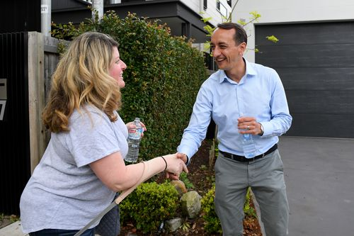 Liberal candidate for Wentworth Dave Sharma is seen handing out how to vote cards near a polling place at Rose Bay.
