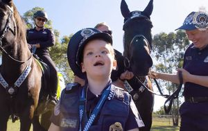 Brisbane boy with incurable tumour sworn in as honourary Queensland Police officer