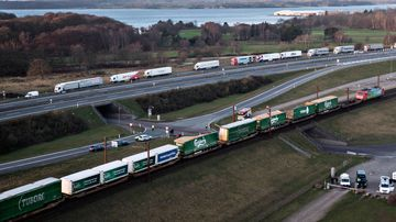 A aerial view of a cargo train with damaged compartments near the Storebaelt bridge, near Nyborg in Denmark.