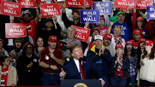 Supporters of President Donald Trump cheer during a rally at the El Paso County Coliseum.