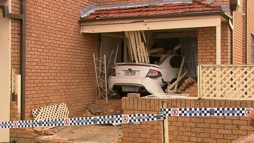 Four people were at home when the car allegedly smashed into their Bexley home. No one was injured. (9NEWS)
