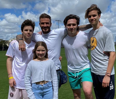 Beckham with his children Brooklyn, 21, Romeo, 17, Cruz, 15, and Harper, seven.