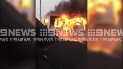 Caravan explodes in ball of flames by roadside