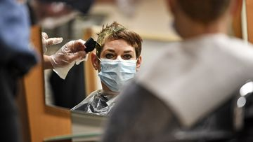 German hairdressers reopen despite coronavirus fears
