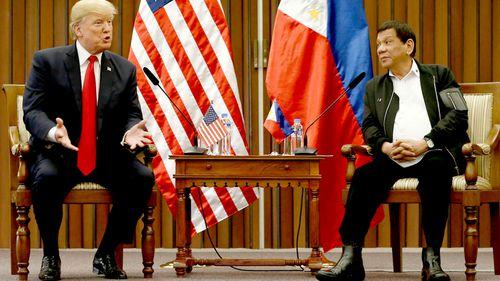 Trump embraces Duterte as Asia trip winds down