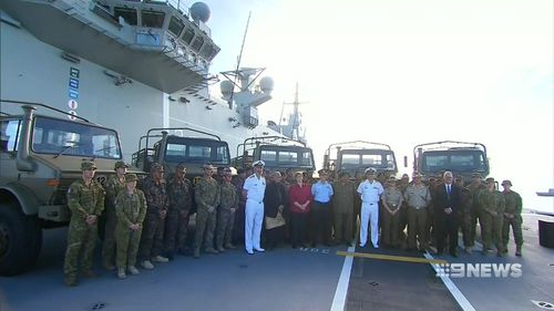 The handing over of the vehicles took place on the HMAS Adelaide. Picture: 9NEWS