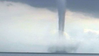 A picture of a waterspout, revealing just how dangerous they an be.