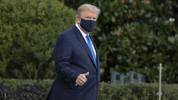 President Donald Trump gives thumbs up as he leaves the White House to go to Walter Reed National Military Medical Centre.