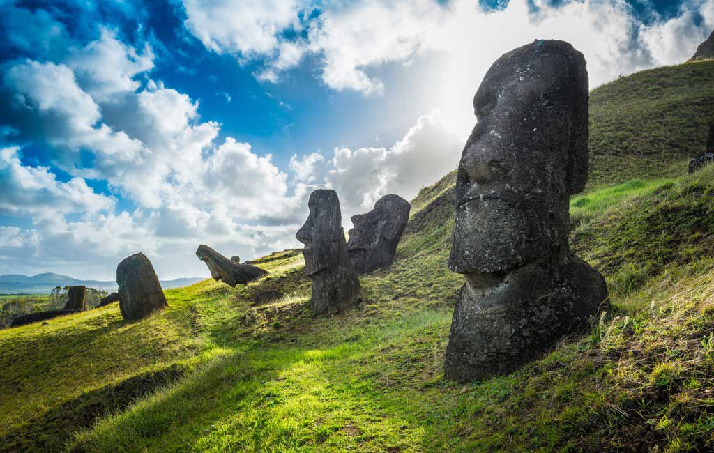 The famous Moai statues stand at Rano Raraku on Easter Island, Chile. Their stone bodies are buried underneath the ground.