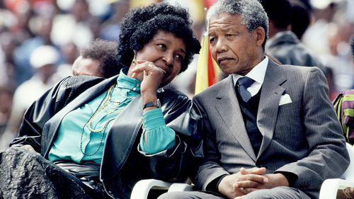 African National Congress leader Nelson Mandela and his wife Winnie Mandela attend a rally in Soweto on February 13, 1990. (Getty)