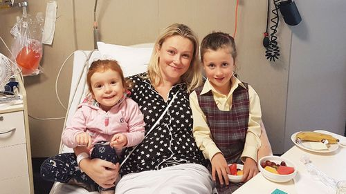 Lindsey Forsyth pictured with Kiera (left) and Aoife in hospital.