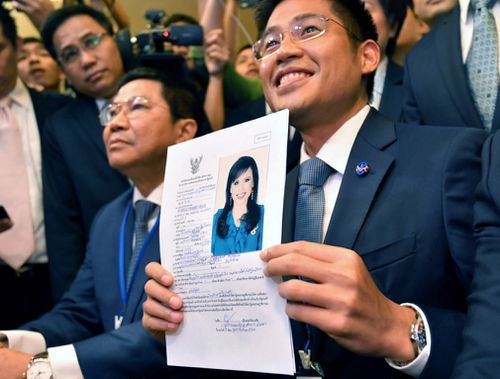 Thai Raksa Chart Party leader Preechapol Pongpanich shows a document nominating Princess Ubolratana Mahidol as candidate for prime minister.