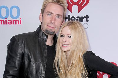 "<b>March 2012:</b> The singers meet to write on Lavigne's album. ""We bonded like crazy. It was like we'd known each other forever,"" she told PEOPLE.<br/><br/><b>July 2012:</b>  Professional turns personal when they begin dating... with Kroeger proposing in August! <br/><br/><b>July 2013:</b>  Eleven months later, they're married.  ""It was three days long. And I don't remember much of that. Oops,"" Lavigne told Chelsea Lately. ""We got married at 9 o'clock at night, partied until 6 in the morning."" <br/>"