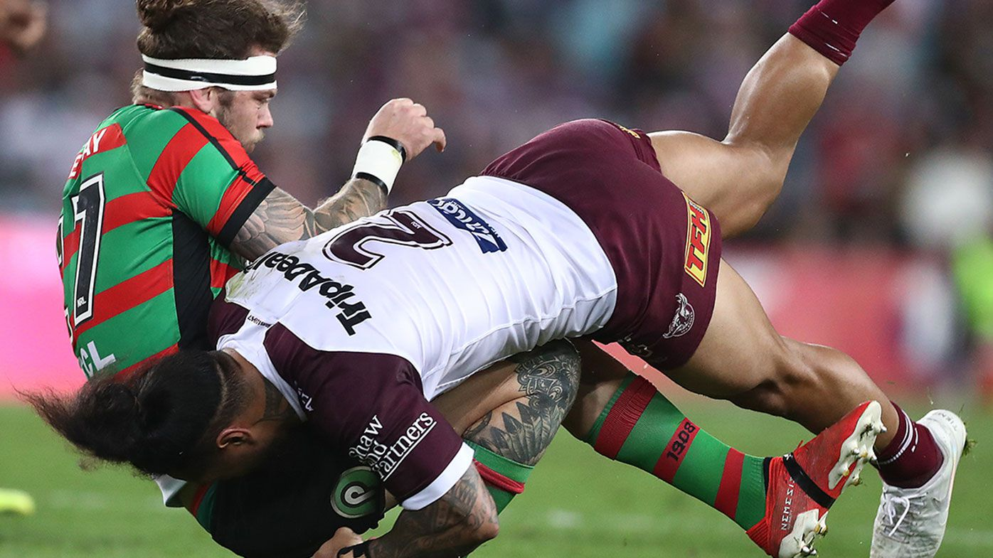 Ethan Lowe is hammered by Jorge Taufua during Souths Sydney's semi final win over Manly.