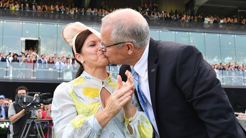Scott Morrison kisses wife Jenny after watching champion racehorse Winx win the Queen Elizabeth Stakes at Royal Randwick.