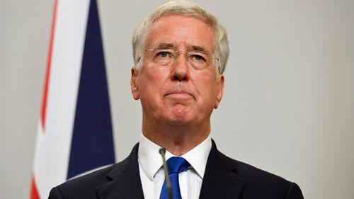 British minister resigns, saying behaviour 'fell short'