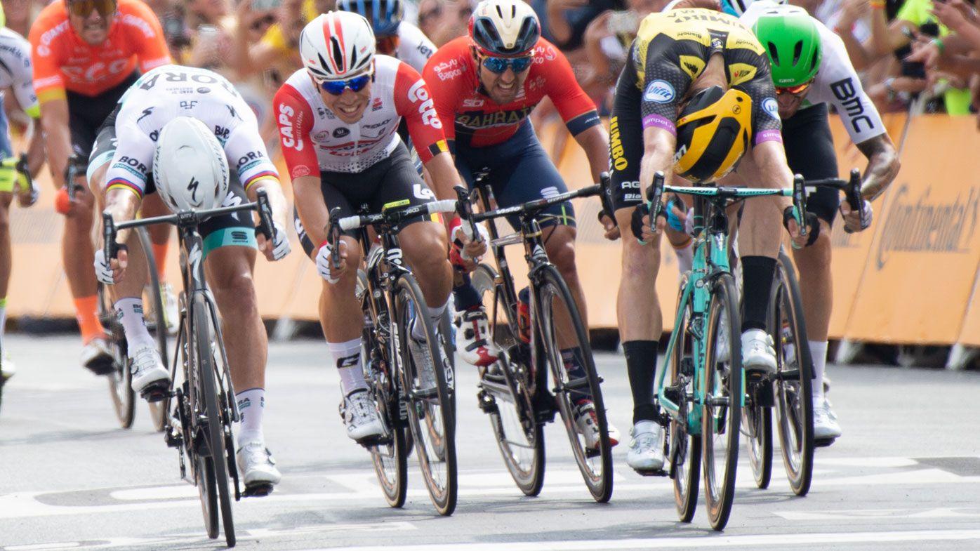Mike Teunissen snatches Tour de France yellow, near miss for Aussie Caleb Ewan
