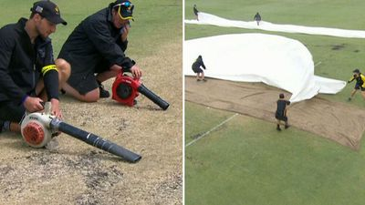 Race to dry Ashes pitch after rain covers misplaced
