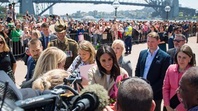 Harry and 'Preggers Meggers' meet adoring crowds