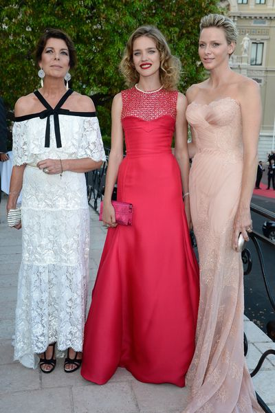 Princess Charlene wearing Atelier Versace alongside Caroline of Hanover and Natalia Vodianova at the 'Love Ball' hosted by Natalia Vodianova in support of The Naked Heart Foundation in Monaco in July, 2013