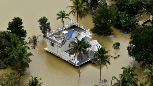 A house is partially submerged in flood waters in Chengannur in the southern state of Kerala, India.