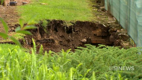 Sinkholes threatening apartment buildings in Sydney's west filled with cement to prevent collapse