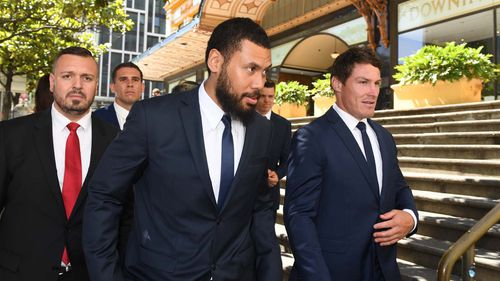 Canterbury Bankstown Bulldogs NRL players Adam Elliott (2nd from left), Asipeli Fine (centre) and team captain Josh Jackson (right) leave the Downing Centre Court following an adjournment in Sydney Monday, December, 17, 2018.
