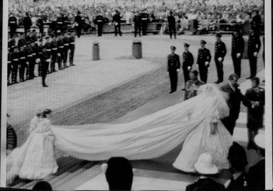 Young bridesmaids Lady Sarah Armstrong-Jones and India Hicks struggle to carry Princess Diana's 7.5 metre bridal train on her wedding day. 1981.