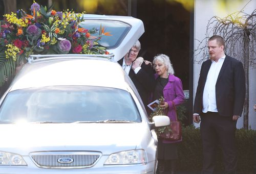 Family and friends of murdered Melbourne comedian Eurydice Dixon are seen during a private funeral service in Brunswick, Melbourne.