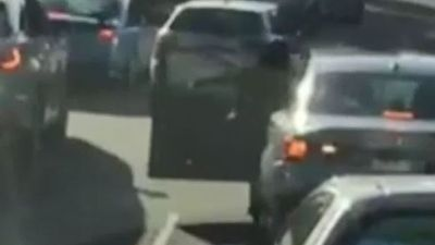 Woman punches driver in road rage attack