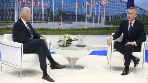 NATO Secretary General Jens Stoltenberg speaks with US President Joe Biden during a bilateral meeting on the sidelines of a NATO summit at NATO headquarters in Brussels.