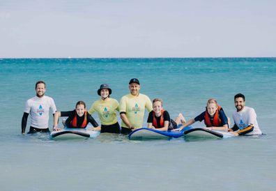 Ocean Heroes volunteers and children photo