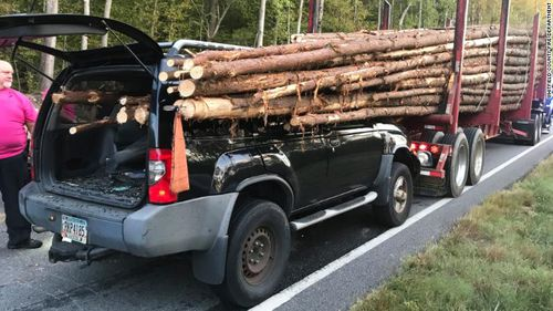The Department shared photos on Facebook showing the car impaled by the logs.