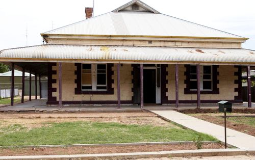 The house at Railway Terrace where convicted murderer Robert Joe Wagner stored dismembered bodies in barrels in the back of a 4wd in the driveway. (AAP Image/Rob Hutchison)
