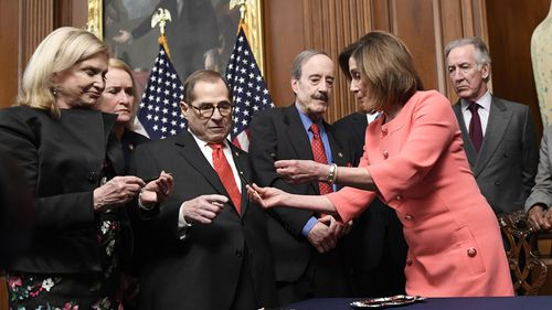 Nancy Pelosi (second from right), gives pens to (L-R) House Oversight and Government Reform Committee Chair Rep. Carolyn Maloney, D-N.Y., Rep. Sylvia Garcia, D-Texas, House Judiciary Committee Chairman Rep. Jerrold Nadler, D-N.Y., House Foreign Affairs Committee Chairman Rep. Eliot Engel, D-N.Y., and House Ways and Means Committee Chairman Rep. Richard Neal, D-Mass., after signing the resolution to transmit two articles of impeachment against Trump (Photo: January 15, 2020)