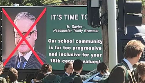 'It's time to go': A truck with the headmasters picture rolls through the school grounds. (9NEWS)